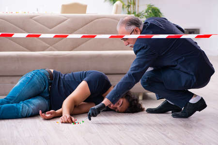Old male forensic expert at crime scene