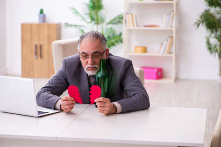 Old man doing marriage proposal via internet