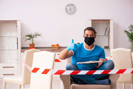 Young male student preparing for exams during pandemic at home