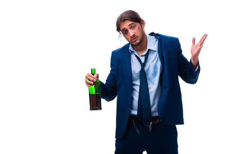 Young male employee alcoholic isolated on white