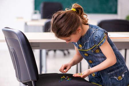 Secondary school prank with sharp thumbtacks on chair