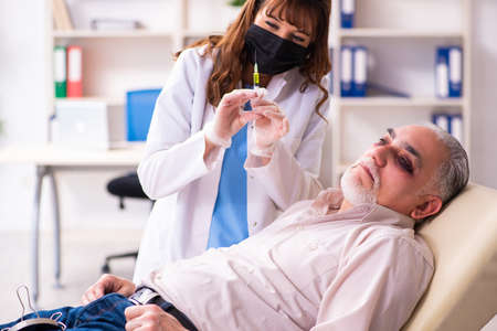 Old man visiting young female doctor for plastic surgery