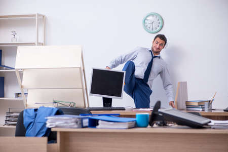Young male employee unhappy with excessive work Stockfoto