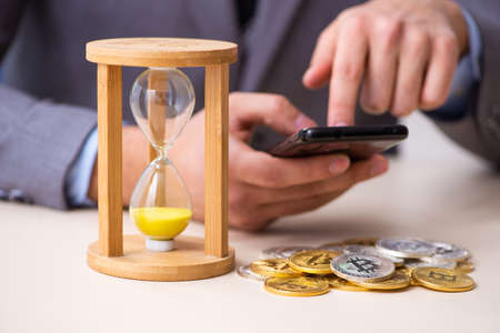 Young man earning money via Internet in time management concept