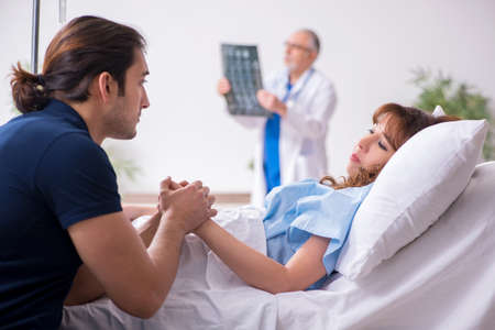 Young husband visiting sick wife in the clinic