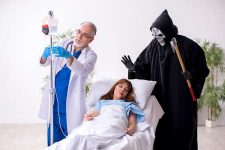 Devil, old doctor and female patient in the clinic Stok Fotoğraf