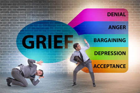 Concept of five stages of grief with businessman