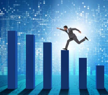 Businessman running towards economic success Banque d'images