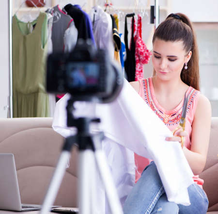 Young woman working as fashion blogger vlogger