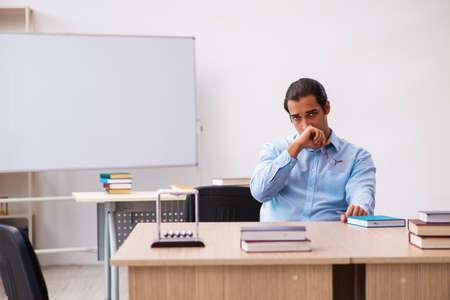 Young male teacher in the classroom Foto de archivo
