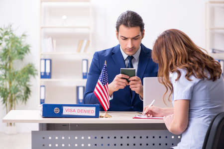 Young woman visiting american embassy for visa Imagens