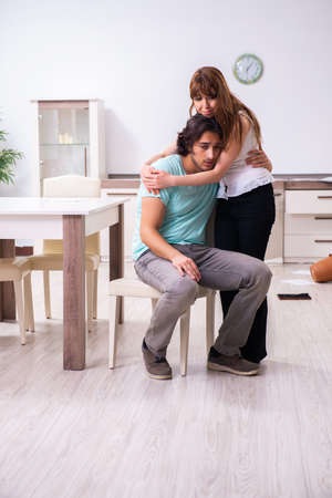 Young couple found their house after burglary robbed by burglars Stock Photo