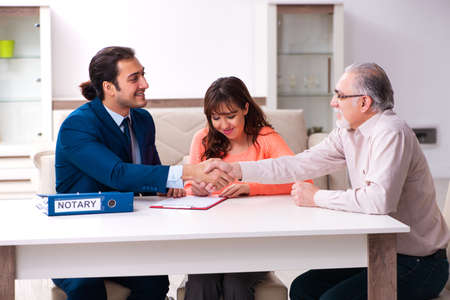 Young male lawyer, old man and his granddaughter in testament co Banco de Imagens