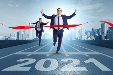 Businessman on finish line to year 2021 Standard-Bild