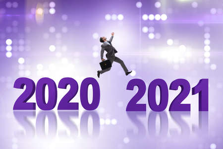 Businessman jumping from the year 2020 to 2021