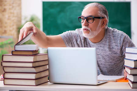Old male student in tele-education concept