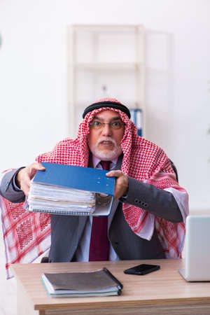 Male arab bookkeeper extremely tired with an excessive work
