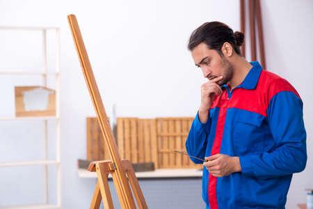 Young male contractor working in workshop 版權商用圖片