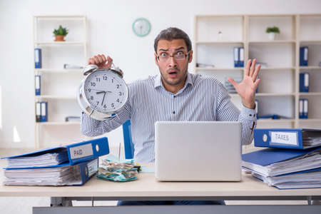 Young male bookkeeper in time management concept