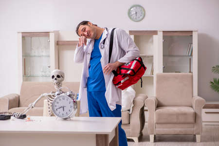 Young male paramedic visiting skeleton patient