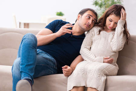 Man and pregnant woman in antismoking concept