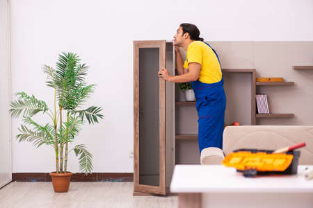 Young male carpenter stealing jewelry at home