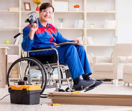 Disabled man laying floor laminate in office 版權商用圖片