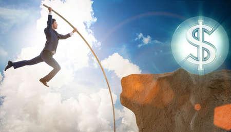 Businessman pole vaulting towards his money goal Stock fotó