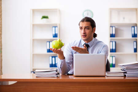 Young male employee in payment concept