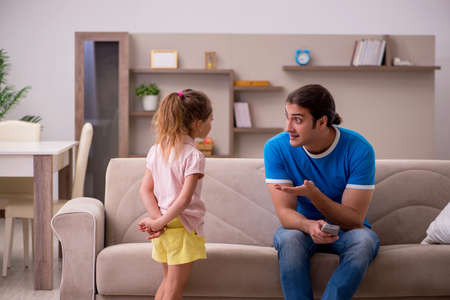 Young man with his daughter at home