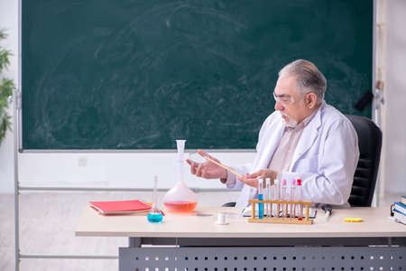 Experienced old scientist working in the lab
