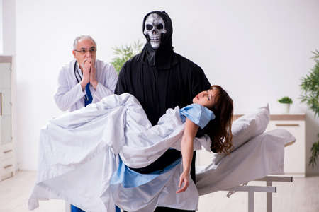 Devil, old doctor and female patient in the clinic
