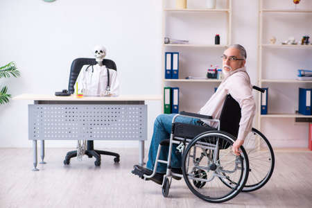 Old man in wheel-chair visiting dead doctor