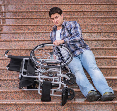 Disabled man on wheelchair having trouble with stairs Фото со стока