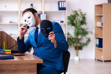 Young male employee wearing mask in the office 免版税图像