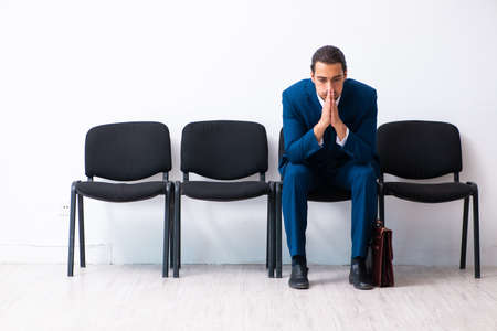 Young businessman waiting for an interview at hall 免版税图像