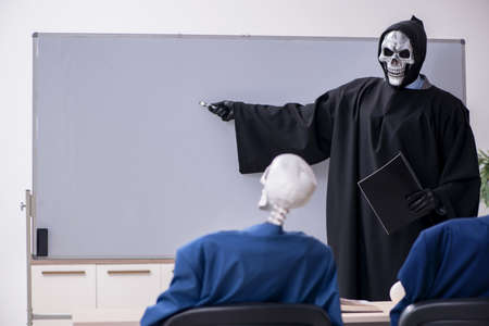 Funny business meeting with devil and skeletons Фото со стока