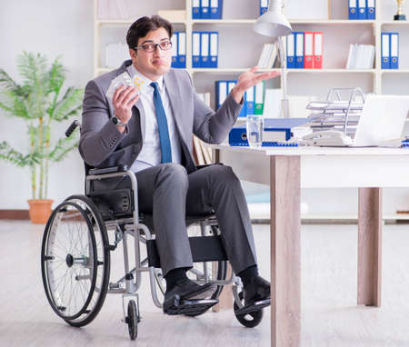 Disabled businessman working in the office Фото со стока