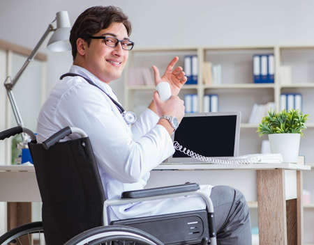 Disabled doctor on wheelchair working in hospital