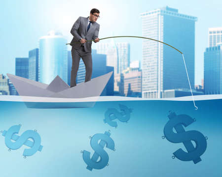 Businessman fishing dollars money from paper boat ship