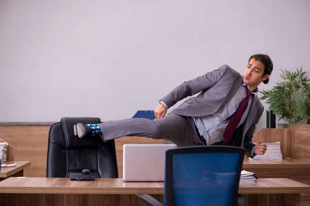 Young businessman employee in bullying concept in the office Foto de archivo