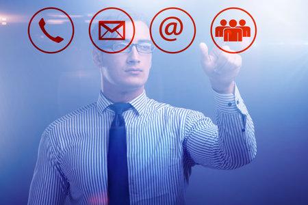 Businessman pressing in communication concept Reklamní fotografie