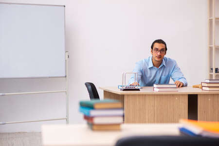 Young male teacher in the classroom