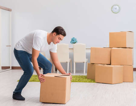 Man carrying boxes at home