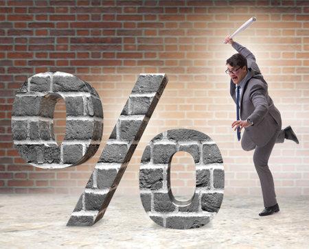 Angry man with baseball bat hitting percentage sign