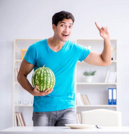 Man eating watermelon at home Reklamní fotografie