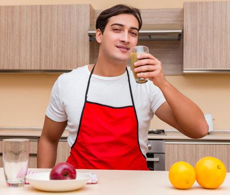 Handsome man working at the kitchen