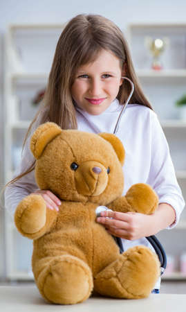 Young girl playing doctor in early development concept