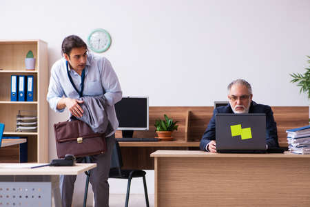 Old boss and his male secretary employee in time management conc Standard-Bild