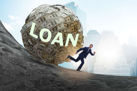 Businessman running away in debt and loan concept